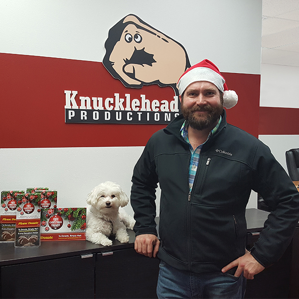 "Josh Leone, spokesman for the annual Conshohocken Free Christmas Dinner project, relaxes with sidekick ""Mr. Pickles"" between efforts to raise additional funds for this year's event. The Dec. 25 holiday meals are free to anyone in need and may be pre-ordered through Dec. 21. Submitted photo"