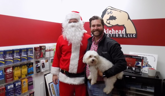 "Santa (aka Brian Coll), Josh Leone, who spearheaded and oversees the Conshohocken Free Christmas Dinner, and Leone's ""Mr. Pickles."" Photo courtesy of subjects"